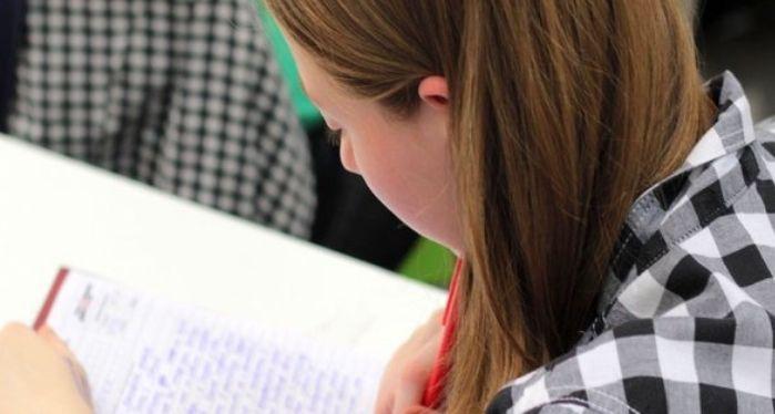 female student taking an exam