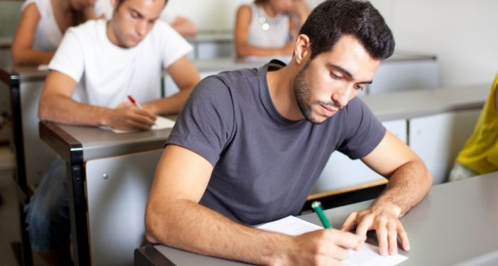 male student sitting for IELTS exam