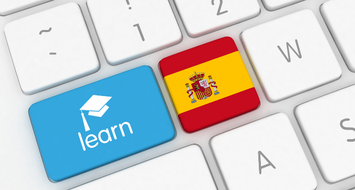 computer keypad with learn and Spanish flag buttons